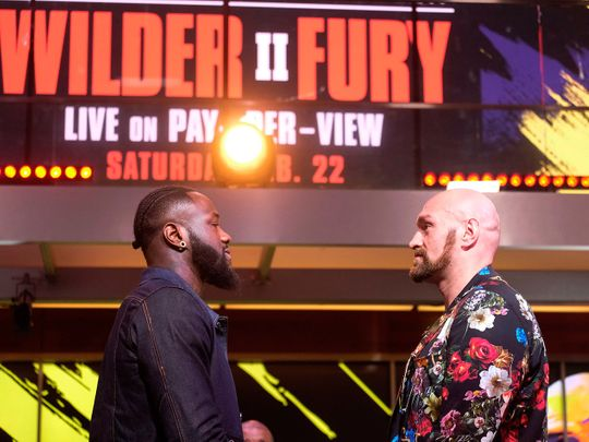 Deontay Wilder and Tyson Fury face-off during a press conference in Los Angeles