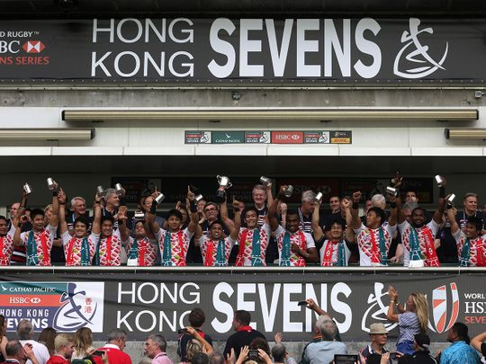 Japan rugby players chee after beating Hong Kong to qualify for the Sevens World Series