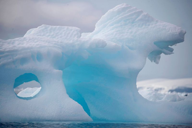 An iceberg floats near Fournier Bay, Antarctica