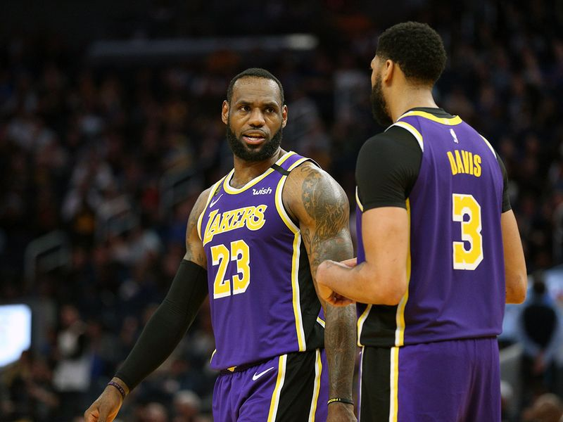 Los Angeles Lakers forward LeBron James (23) talks with center Anthony Davis