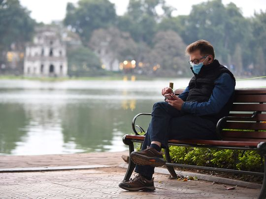 A man wears a protective mask in Hanoi