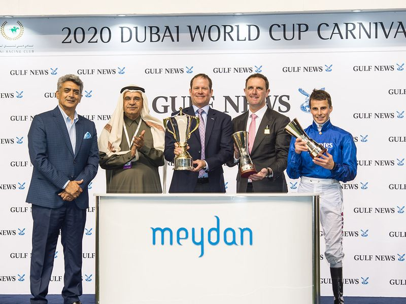 Abdul Hamid Ahmad, Executive Director Publications & Editor-In-Chief and Rajeev Khanna, Commercial Director, Al Nisr Publishing presentng trophies to Rod Daniel, trainer Charlie Appleby and jockey William Buick after Magic Lily wion the Balanchine Stakes race sponsored by Gulf News during Dubai World Cup Carnival meeting at Meydan racecourse on Thursday 13 February 2020. Photo: Virendra Saklani/Gulf News