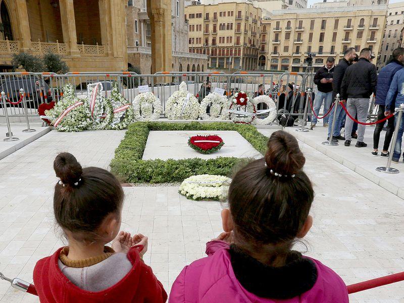 Girls pray at the grave of former Lebanese prime minister Rafik Hariri, marking the 15th anniversary of his assassination, in downtown Beirut, Lebanon February 14.