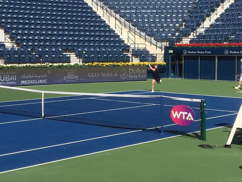 Kim Clijsters practises for Dubai Duty Free Tennis Championships