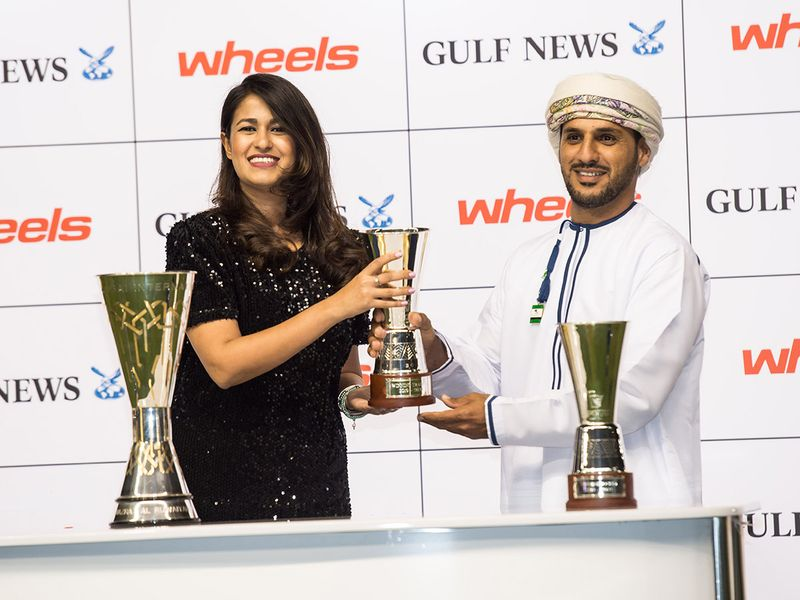 Mariam Hozefa, Senior account Group Manager-Wheels  presenting trophy to trainer Sulaiman Ali Ghunaimi after Rasi, won the Mazrat Al Ruwayah race sponsored by Wheels from Gulf News during Dubai World Cup Carnival meeting at Meydan racecourse on Thursday 13 February 2020. Photo: Virendra Saklani/Gulf News