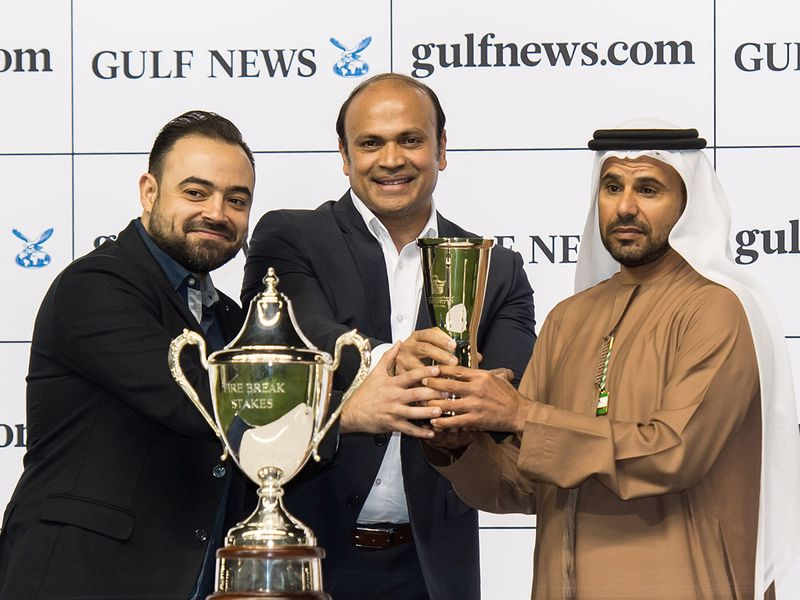 Sandeep Suvarna, Digital Adversiting Sales Manager and Mohamed Ziaour, Senior Account Group Manager-Digital presenting trophy to trainer Salem Bin Ghadayer after Capezzano won the Firebreak Stakes  race sponsored by gulfnews.com during Dubai World Cup Carnival meeting at Meydan racecourse on Thursday 13 February 2020. Photo: Virendra Saklani/Gulf News