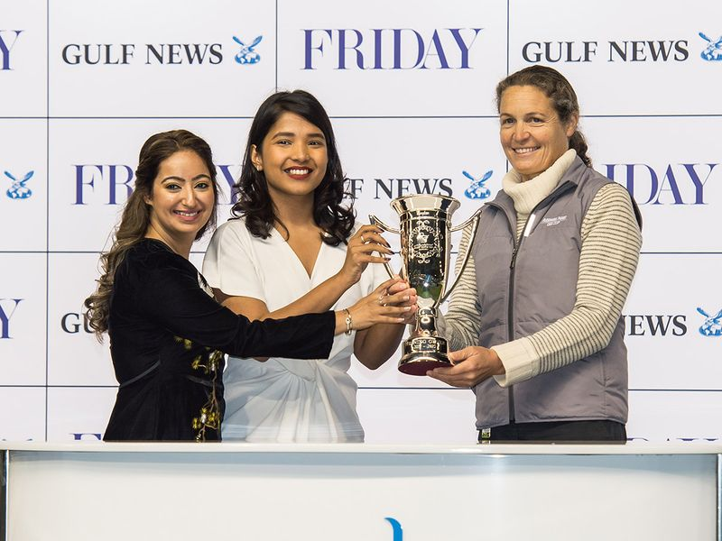 Shruti More and Taruna Sajnani, Account Group Manager-Friday presenting trophy to Sophie Chretien after Eynhallow won Friday race sponsored by Gulf News during Dubai World Cup Carnival meeting at Meydan racecourse on Thursday 13 February 2020. Photo: Virendra Saklani/Gulf News