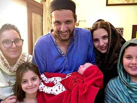 Shahid Afridi poses with his family and new addition