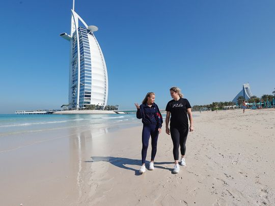 Sofia Kenin and Kim Clijsters chat on the beach