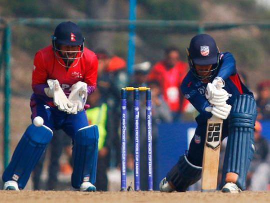 US cricketer Akshay Homraj plays a shot during the one day international (ODI) cricket match of the ICC Cricket World Cup League 2 against Nepal at the Tribhuwan University International Cricket Ground, in Kathmandu on February 12, 2020. The United States were bowled out for 35 by Nepal on Wednesday and joined Zimbabwe in making the lowest total in a 50 over international. / AFP / STR