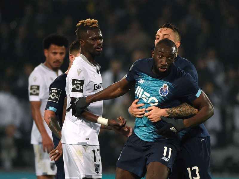 Porto's Malian forward Moussa Marega (C) reacts and attempts to leave the pitch after hearing racists chants