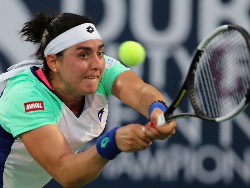 Tunisia's Ons Jabeur returns the ball to Alison Riske from the U.S. during a match of the Dubai Duty Free Tennis Championship in Dubai, United Arab Emirates