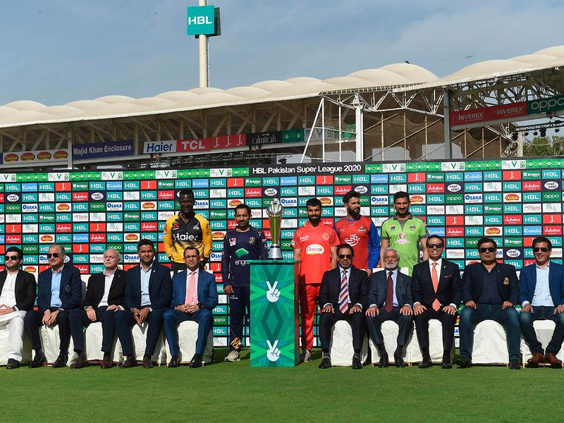 Darren Sammy of Peshawar Zalmi, Sarfraz Ahmed of Quetta Gladiators, Shadab Khan of Islamabad United, Imad Wasim of Karachi Kings and Sohail Akhtar of Lahore Qalandars pose with the PSL trophy and cricket officials during the trophy unveiling ceremony at the Karachi National Stadium