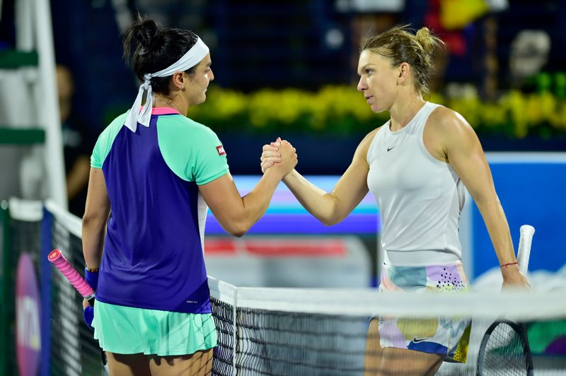Ons Jabeur congratulates Simona Halep after the match at the Dubai Duty Free Tennis Championships