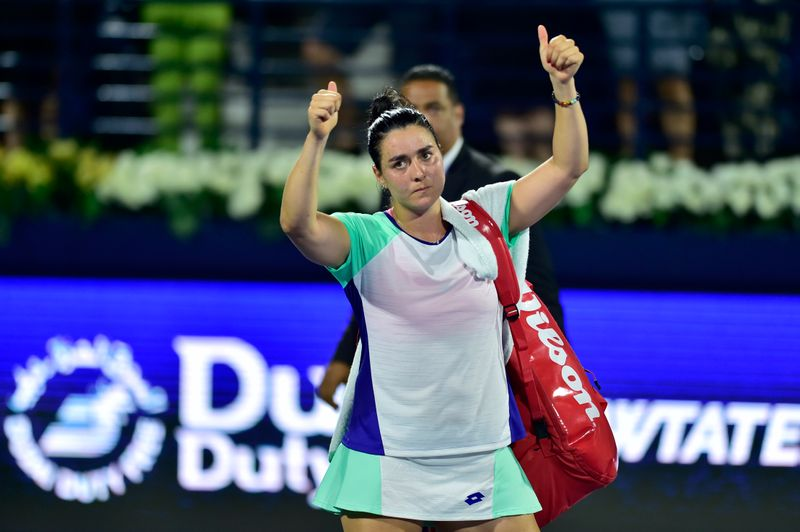 Ons Jabeur reacts during the game against Simona Halep at the Dubai Duty Free Tennis Championships