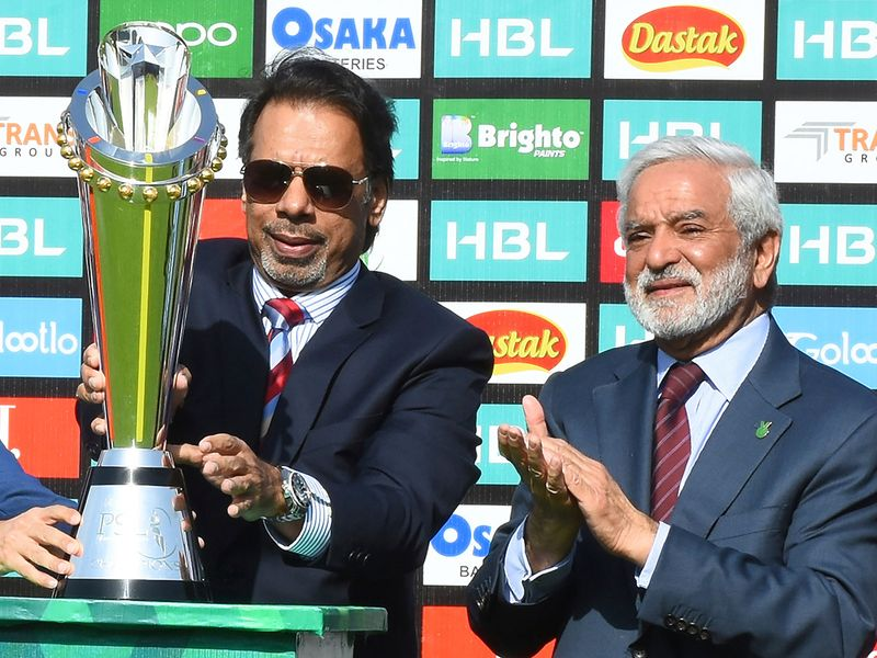 Pakistan's former squash world champion Jahangir Khan unveils the PSL trophy at the National Stadium in Karachi, Pakistan with Chief of Pakistan Cricket Board Ehsan Mani, right, Wednesday, Feb. 19, 2020. Pakistan's premier domestic Twenty20 cricket league begins from Thursday with the final scheduled to be played at Lahore on March 22, 2020. (AP Photo/Fareed Khan)