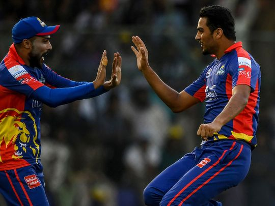 Karachi Kings' Arshad Iqbal  and Mohammad Amir celebrate after the dismissal of Peshawar Zalmi's Shoaib Malik