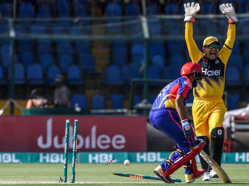 Peshawar Zalmi's Kamran Akmal (R) makes an appeal for a runout against Karachi Kings's Babar Azam (L) during the Pakistan Super League (PSL) Twenty20 cricket match between Peshawar Zalmi and Karachi Kings at the National Cricket Stadium in Karachi on February 21, 2020.