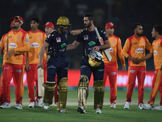 Quetta Gladiators' Ben Cutting (front R) and Abdul Nasir (front L) walk back the pavilion after winning the Pakistan Super League (PSL) Twenty20 cricket match between Quetta Gladiators and Islamabad United at The National Cricket Stadium in Karachi on February 20, 2020.  / AFP / Asif HASSAN