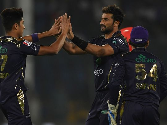 Quetta Gladiators's Sohail Khan (2R) celebrates with team mate Mohammad Hasnain (L) after the dismissal of Islamabad United's Amad Butt (unseen) during the Pakistan Super League (PSL) Twenty20 cricket match between Quetta Gladiators and Islamabad United at The National Cricket Stadium in Karachi on February 20, 2020.  / AFP / Asif HASSAN