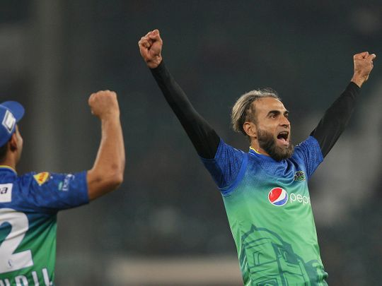 Imran Tahir of Multan Sultans celebrates after claiming the wicket of Lahore Qalandars' Mohammad Hafeez in the Pakistan Super League match in Lahore