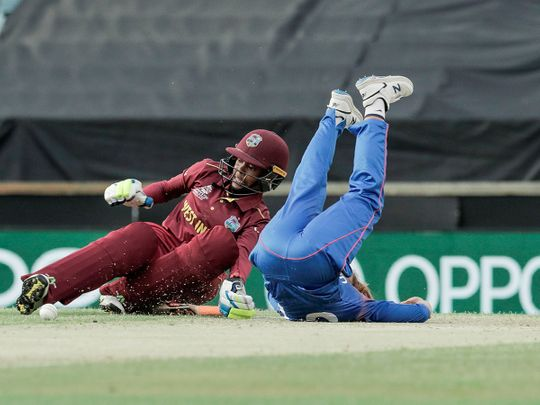 Shemaine Campbelle of the West Indies (L) collides with Wongpaka Liengprasert of Thailand during the women's Twenty20 World Cup cricket match in Perth