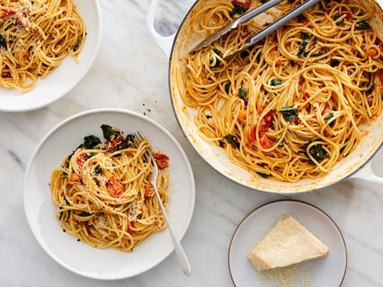 Spaghetti with cherry tomatoes and kale.-1582461909820