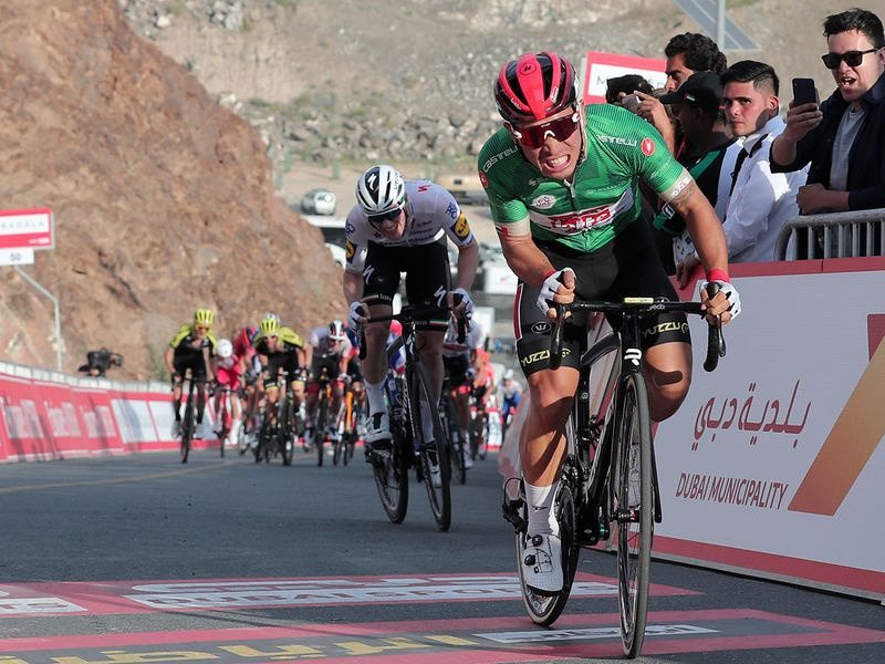 Australian rider Caleb Ewan of Lotto Soudal approaches finish line to win the second stage of the UAE cycling tour in Dubai, United Arab Emirates, Monday, Feb, 24, 2020. (AP Photo/ Mahmoud Khaled)