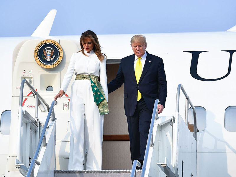 Donald Trump and Melania Trump disembark from Air Force One upon their arrival at Agra Air Base.