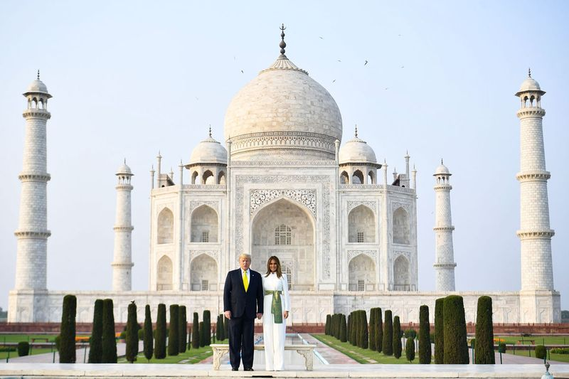 Donald Trump and Melania Trump pose as they visit the Taj Mahal in Agra.