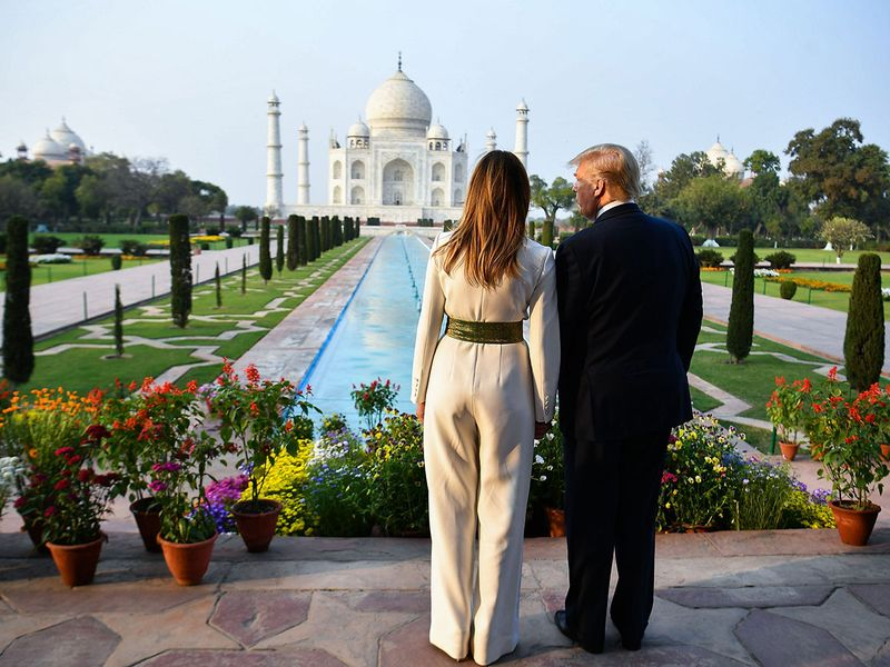 Donald Trump and Melania Trump visit the Taj Mahal in Agra.