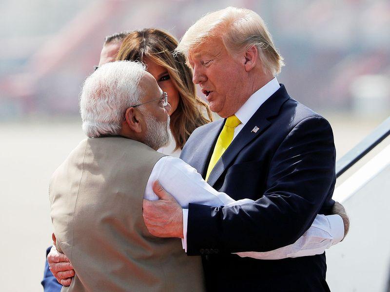 Donald Trump greets Narendra Modi as he arrives at Sardar Vallabhbhai Patel International airport in Ahmedabad.