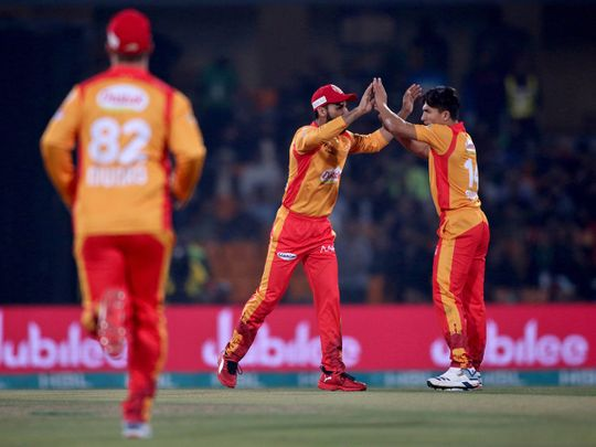 Islamabad United pacer Muhammad Musa, right, celebrates with Shadab Khan