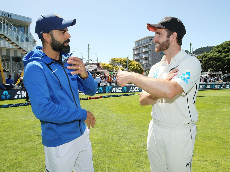 Kane Williamson talks to India's Virat Kohli