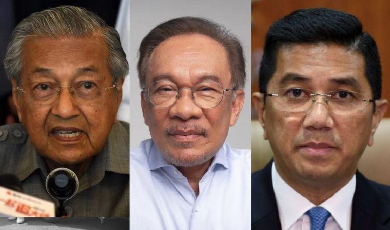 Mahathir Mohamed, Anwar Ibrahim and Malaysia's Economic Affairs Minister Mohamed Azmin Ali