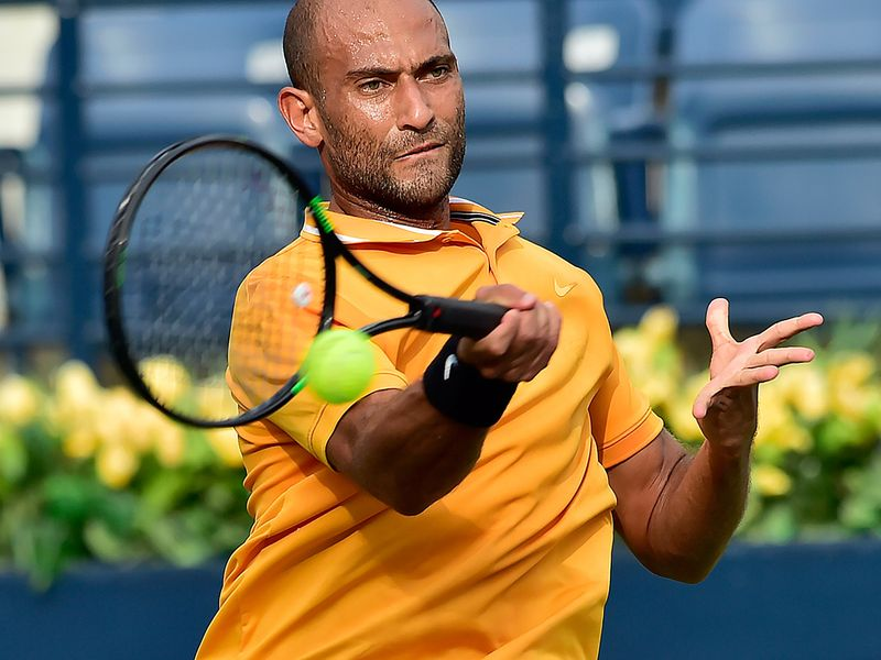 Mohamed Safwat in action against Philipp Kohlschreiber at the Dubai Duty Free Tennis Championships on 24th February, 2020. Photo Clint Egbert/Gulf News