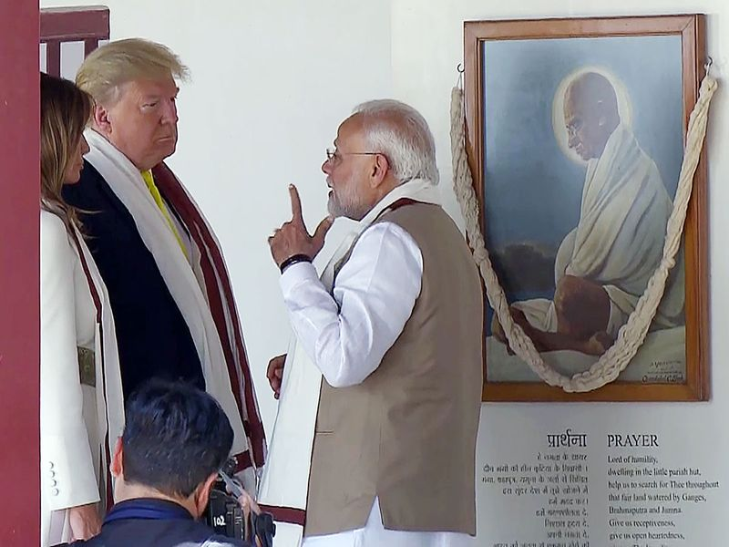 Narendra Modi, Donald Trump and Melania Trump at Sabarmati Ashram in Ahmedabad.