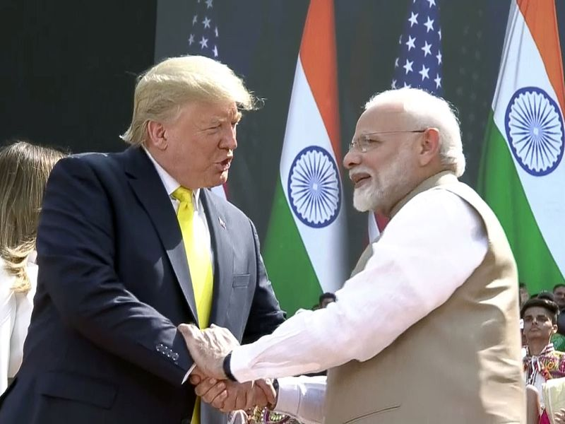 Narendra Modi shakes hand with Donald Trump during the 'Namaste Trump' event at Motera Stadium in Ahmedabad.
