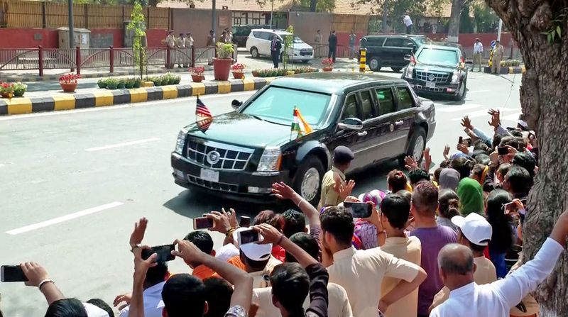 People wave as Donald Trump, Melania Trump, and Narendra Modi enroute Motera Stadium, in Ahmedabad.