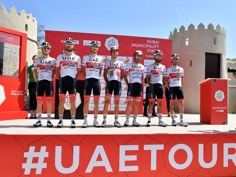 The UAE Team Emirates cyclists line up before the start