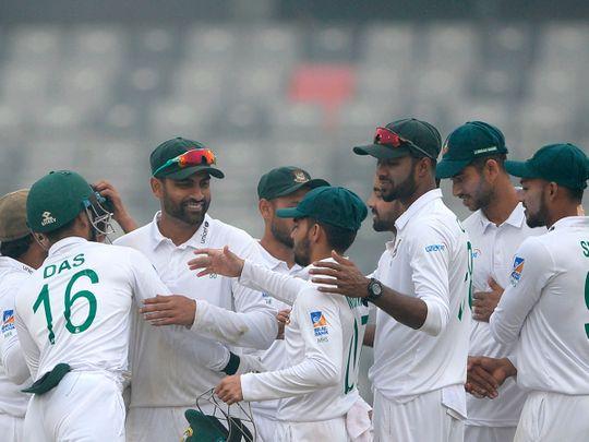 Bangladeshi cricketers celebrates after winning the test match between Bangladesh and Zimbabwe during the fourth day at the Sher-e-Bangla National Cricket Stadium in Dhaka on February 25, 2020. / AFP / MUNIR UZ ZAMAN