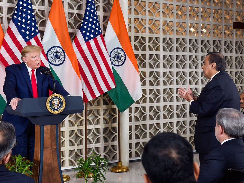 Donald Trump interacts with Reliance Industries Chairman Mukesh Ambani during a meeting with business leaders at US embassy in New Delhi.