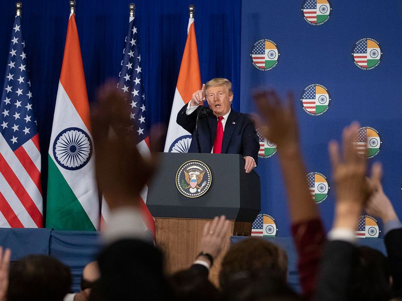 Donald Trump points to a question during a news conference, in New Delhi.