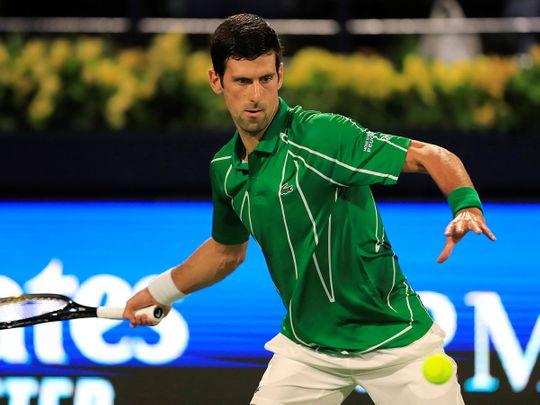 Novak Djokovic in action against Jaziri