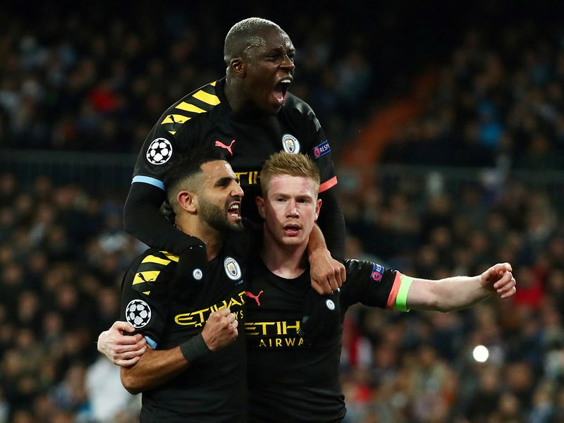 ccer Football - Champions League - Round of 16 First Leg - Real Madrid v Manchester City - Santiago Bernabeu, Madrid, Spain - February 26, 2020  Manchester City's Kevin De Bruyne celebrates scoring their second goal with Riyad Mahrez and Benjamin Mendy  REUTERS/Sergio Perez