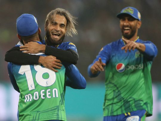 Imran Tahir, center, of Multan Sultan celebrates a dismissal of Karachi Kings' batsman during the Pakistan Super League T20 cricket match in Multan, Pakistan, Friday, Feb. 28, 2020. (AP Photo/K.M. Chaudhry)