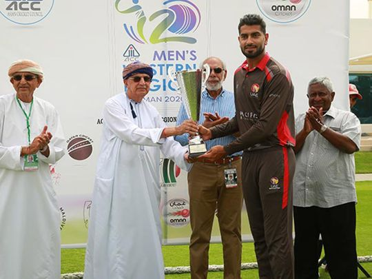 UAE captain Ahmad Raza received the Asian Cricket Council Western Region T20 tournament trophy from Kanak Khimji, Chairman of Oman Cricket and Sultan Rana, ACC's Events and Development Manager. Picture: ACC
