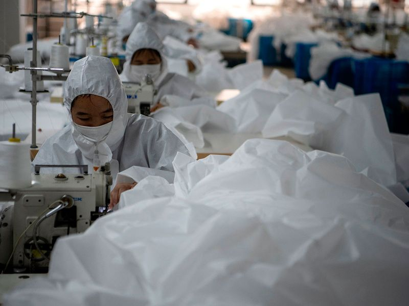In virus-hit China, coat maker adapts to make hazmat suits