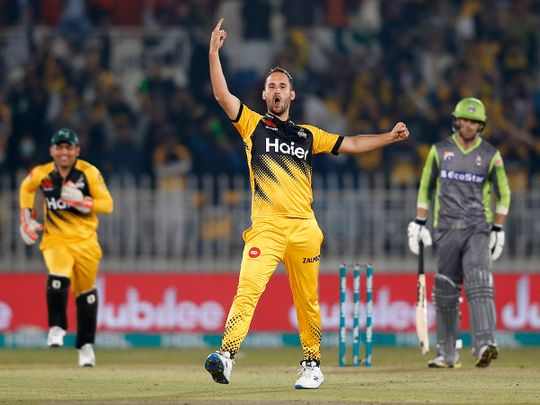 Peshawar Zalmi pacer Lewis Gregory, center, reacts after taking the wicket of Lahore Qalandars batsman Chris Lynn, right, during their Pakistan Super League T20 cricket match at Rawalpindi stadium in Rawalpindi, Pakistan, Friday, Feb. 28, 2020. (AP Photo/Anjum Naveed)