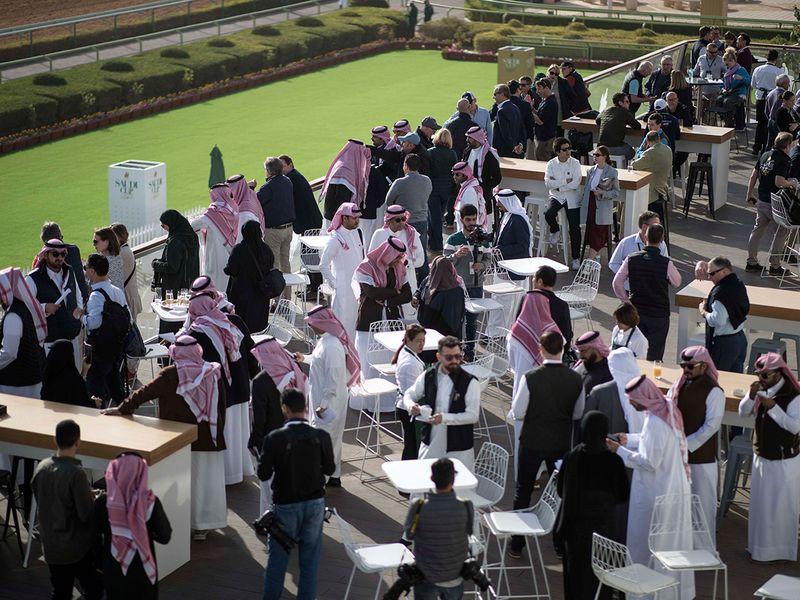 Racegoers gather ahead of the Saudi Cup